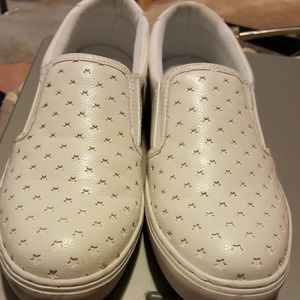 white star cut out slip ons